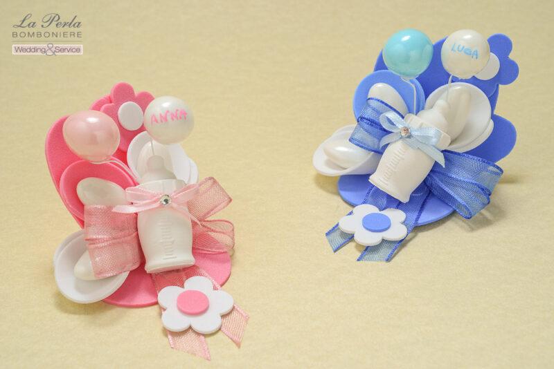 Simpatici gessetti profumati a forma di Biberon e palloncini formati da noccioline ricoperte di cioccolato bianco, rosa e azzurro. Made in Italy