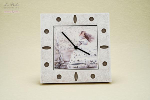 """Orologio """" L'abbraccio"""", interamente fatto a mano utilizzando la carta mista alla pietra, firmato CARTAPIETRA . Made In Italy."""