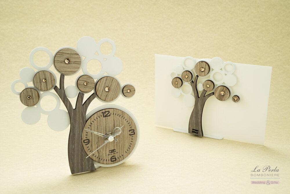 Orologio e Portadocumenti Albero della Vita in metallo e legno intagliati al laser Made in Italy.