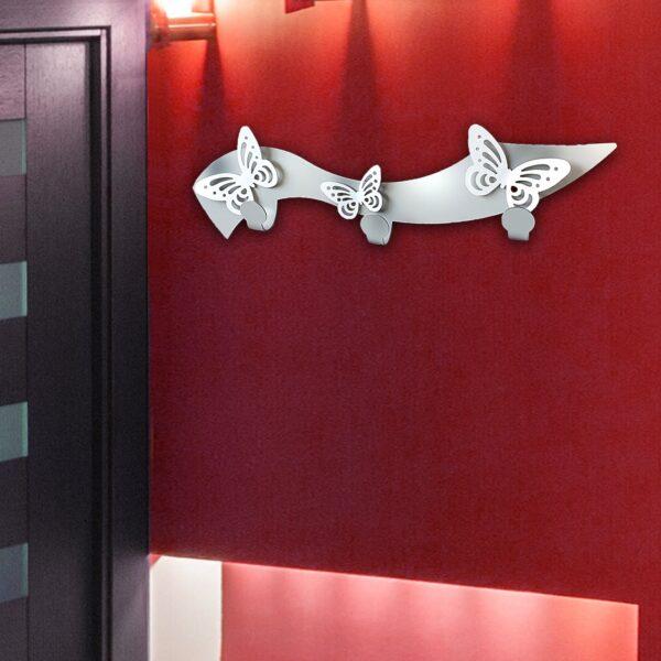 Appendiabiti con farfalle in metallo intagliato al laser. Made in Italy. Possibilità di personalizzare colore e decoro.